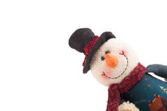 Snowman looking out of the corner isolated on a white background Stock Photos