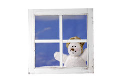 Snowman looking trough a window Royalty Free Stock Photo