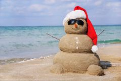 Snowman made out of sand. Holiday concept can be used for New Year and Christmas Cards Royalty Free Stock Images