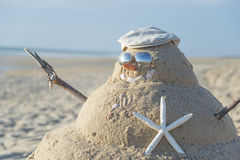 Snowman Made Out Of Sand With Hat Stock Photography