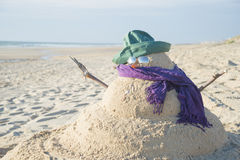 Snowman Made Out Of Sand With Hat Stock Image