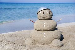 Snowman made out of sand. Holiday concept Royalty Free Stock Photo