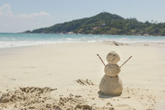 Snowman made of sand on a background of the tropical warm sea Stock Image