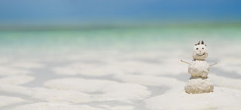 Snowman made from sand on beach Stock Photography