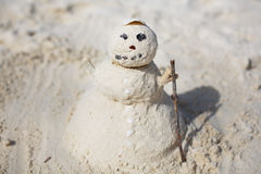 Snowman made of sand on the beach Royalty Free Stock Images