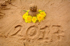 Snowman made of sand. Snowman out of sand. children's sand crafts. dandelions. the warm winter Stock Photography