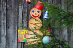 A snowman made of wood blocks. To celebrate Christmas during a snowless winter Royalty Free Stock Photo