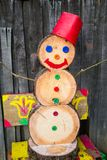 A snowman made of wood blocks. To celebrate Christmas during a snowless winter Stock Photography