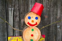 A snowman made of wood blocks. To celebrate Christmas during a snowless winter Stock Image