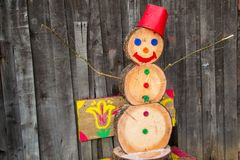 A snowman made of wood blocks. To celebrate Christmas during a snowless winter Royalty Free Stock Photos