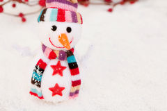 Snowman made of wool over the snow. Christmas decoration Royalty Free Stock Images