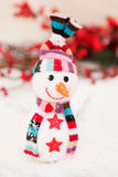 Snowman made of wool over the snow. Christmas decoration Stock Images
