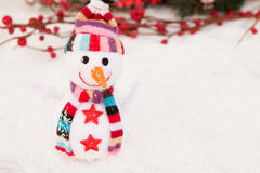 Snowman made of wool over the snow. Christmas decoration Royalty Free Stock Photography