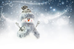 Snowman. On a magical Christmas background Royalty Free Stock Photos