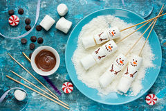 Snowman marshmallow pops Christmas food art idea Stock Images