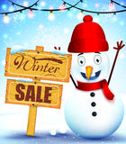 Snowman Mascot Winter Sale In A Wood Sign For Winter Promotion Stock Photography