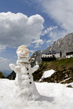 Snowman melting in the spring thaw. Snowman in Austria melting in the spring thaw stock photos