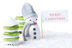 Snowman with Merry Christmas sign. Cute festive snowman with Merry Christmas sign isolated on white background Stock Photos