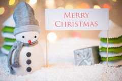 Snowman with Merry Christmas sign Stock Photography