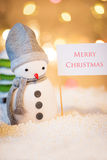 Snowman with Merry Christmas sign Stock Photos