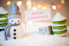 Snowman with Merry Christmas sign Stock Photo