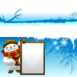 Snowman with message board Stock Photos