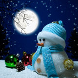 Snowman and moon. Snowman with the moon behind Royalty Free Stock Images