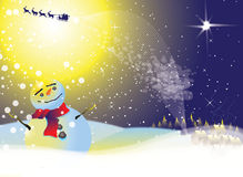 Snowman in Moonlight. A snowman on top of a hill bathed in yellow moonlight wearing a red scarf. Santa and his reindeer fly across a star lit snowy dark blue Stock Photo