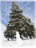Snowman and mountain river  Fir trees. Stock Photo