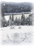 Snowman and mountain river  Fir trees. Stock Image