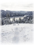 Snowman and mountain river  Fir trees. Royalty Free Stock Images
