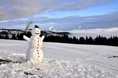 Snowman in the mountains Royalty Free Stock Photos