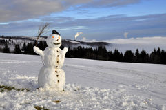 Snowman in the mountains Royalty Free Stock Photo