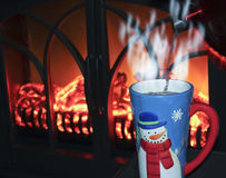 A Snowman Mug of Cocoa by the Fire Royalty Free Stock Images