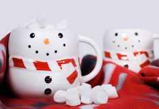 Snowman mugs with hot chocolate and marshmallows Royalty Free Stock Images