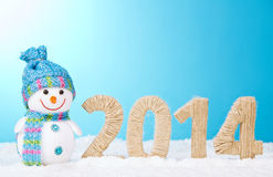 Snowman near and figures 2014 Royalty Free Stock Photos