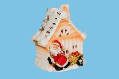 Snowman near a house Royalty Free Stock Image