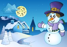 Snowman near small village Stock Image