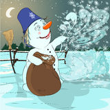 Snowman in a new years eve. The snowman in eve of new year creates a snow blizzard Royalty Free Stock Image