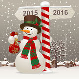 Snowman with a New Year sign Stock Images