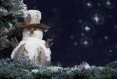 Snowman next to Christmas tree Royalty Free Stock Photo