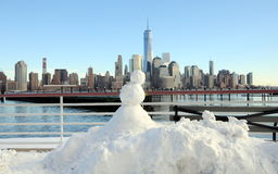 Snowman and NYC Royalty Free Stock Photos