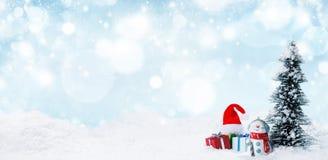 Snowman och julpynt royaltyfria foton