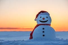 Snowman. On orange sunset background Stock Image