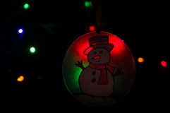 Snowman ornament in glowing lights. Royalty Free Stock Images