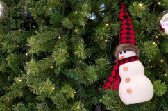 Snowman ornament hanging on christmas a tree Stock Photo