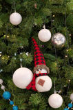 Snowman ornament hanging on christmas a tree Stock Photography