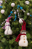 Snowman ornament hanging on christmas a tree Royalty Free Stock Photography