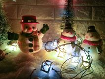 Snowman and ornament lighting bulb at silent night, holy night, Merry Christmas and Happy new year. stock images