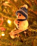 Snowman. A snowman ornament photograph will make a great Christmas card cover Stock Photos